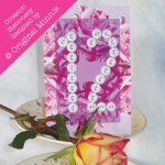 Original Minnie © Wedding and Occasion Stationery 2010 - Table Number with vintage buttons from my Painted Rose range